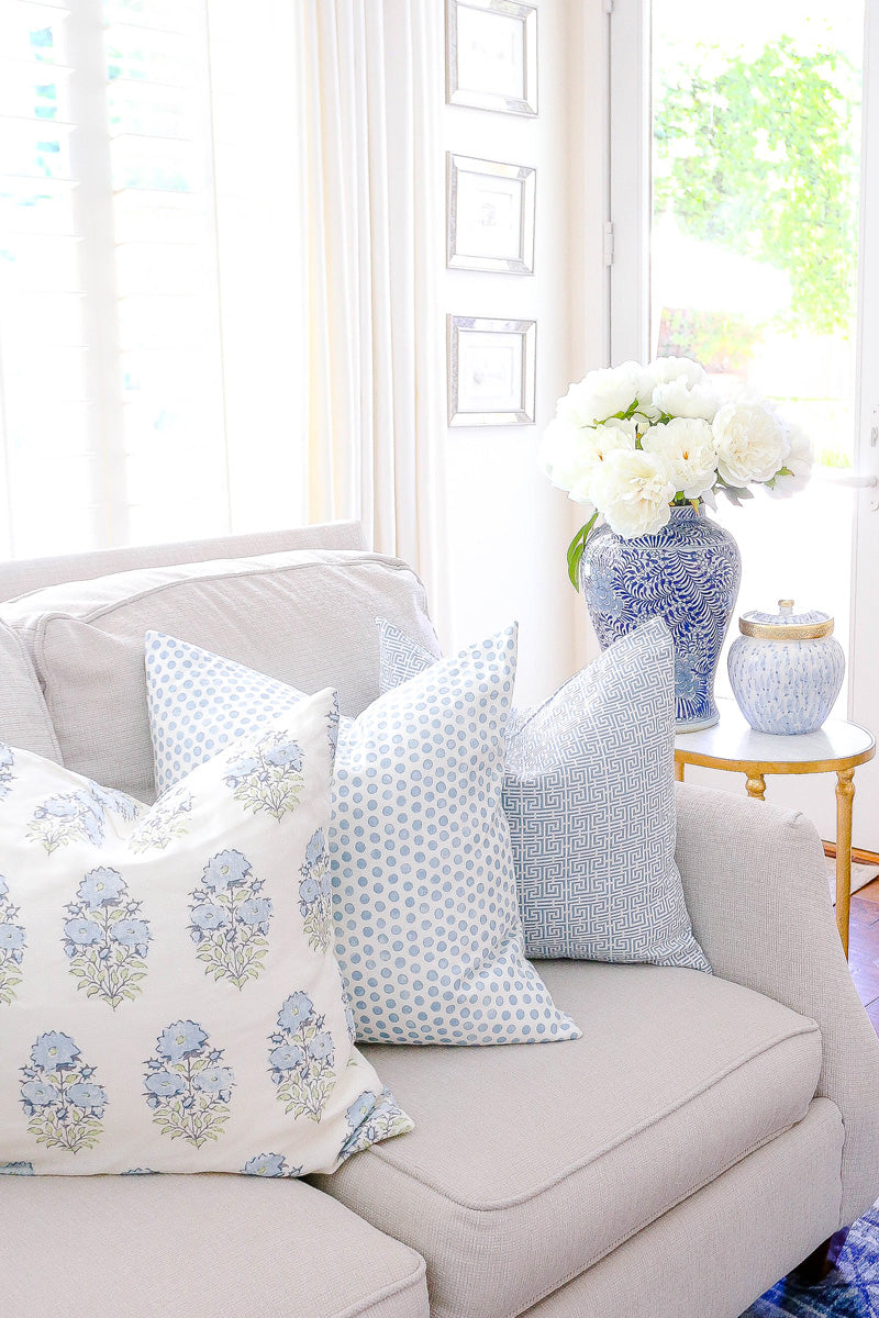 Blue and white patterned pillow for spring living room decor | design by Randi Garrett