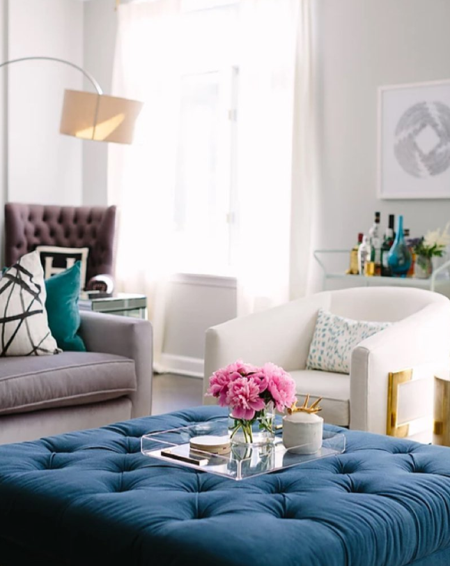 living room with grey sofa and blue tufted ottoman | pillows from Arianna Belle | interior design by Alex Kaehler
