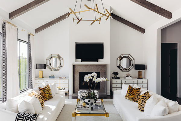 black and white chic living room with animal print pillows by Paloma Contreras