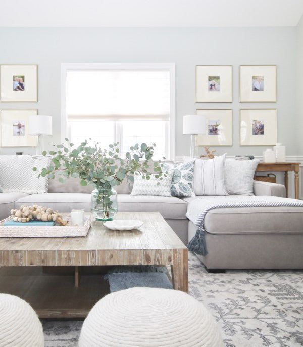living room with comfy grey sectional sofa with mix of blue pillows in different patterns | interior design by Jess Weeth | Arianna Belle Blog