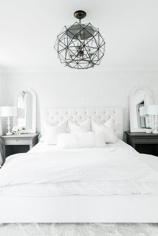 Designer Spotlight Kate + Amanda | Arianna Belle Blog | white and black modern glamorous bedroom white tufted headboard and unique ceiling fixture
