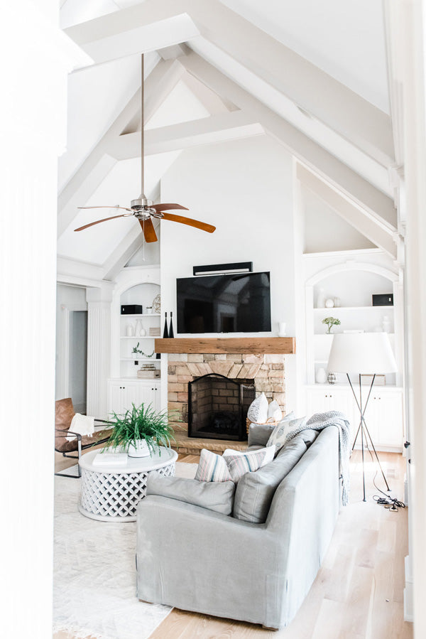 Designer Spotlight: Kate + Amanda | Arianna Belle Blog | living room with high ceilings fireplace and cozy grey sofas