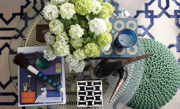 blue and green coffee table styling details with white hydrangeas | Designer Spotlight: Meredith Heron | Arianna Belle Blog