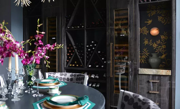 glamorous dark grey dining space with wine racks and asian influences | Designer Spotlight: Meredith Heron | Arianna Belle Blog