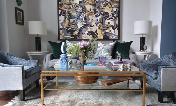 luxury living room with designer pillows and abstract art | Designer Spotlight: Meredith Heron | Arianna Belle Blog