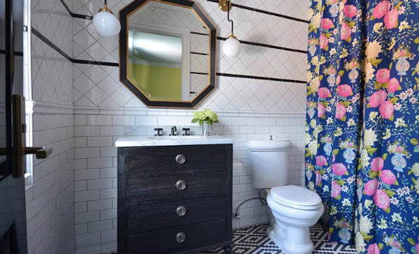 black and white bathroom with subway tile, patterned floor, floral designer fabric shower curtain | Designer Spotlight: Meredith Heron | Arianna Belle Blog
