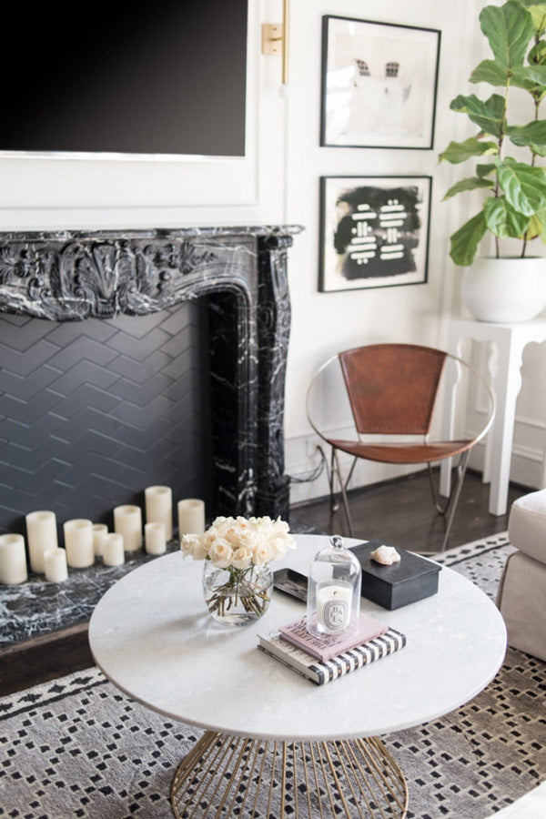 interior designer Shannon Claire Smith | black fireplace leather chair round coffee table | Designer Spotlight series Arianna Belle Blog