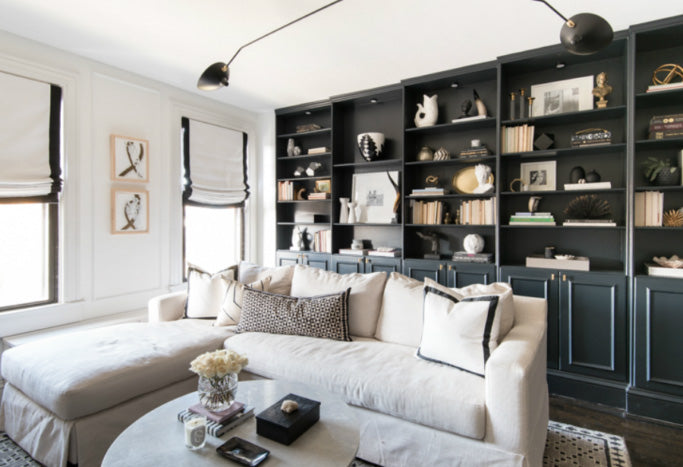 interior designer Shannon Claire Smith | black and white living room with sectional and pillows