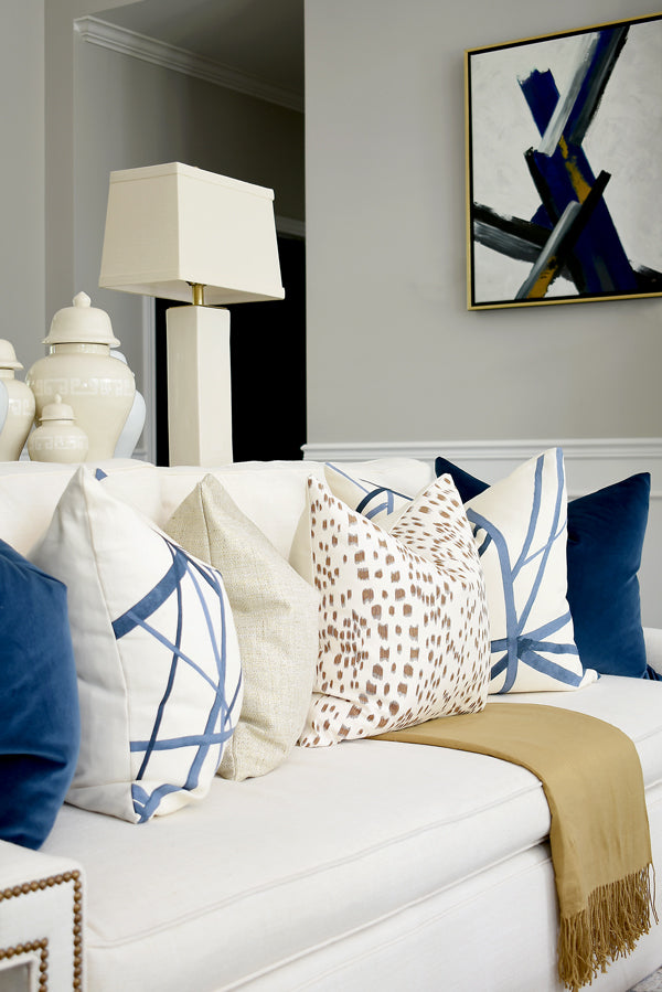 Designer pillow combo of rich gold and brown tones paired with navy and cream | from Arianna Belle