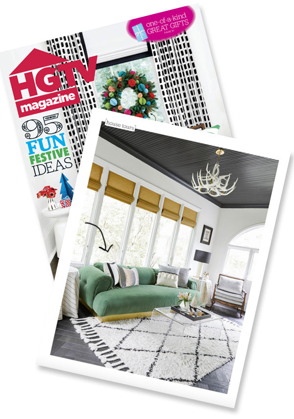 Modern black white and green living room designed by Nicole Botsman with white solid pillow with black border from Arianna Belle as seen in HGTV magazine