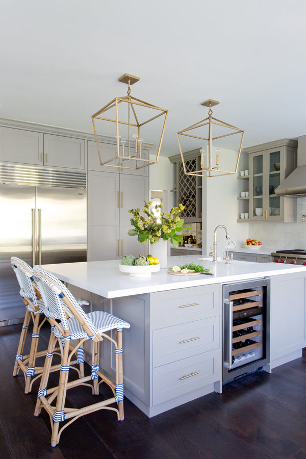 Designer Spotlight: Jenn Feldman | grey kitchen with white counters french bistro chair stools brass fixtures