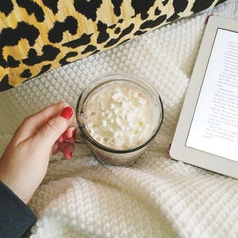 cup of hot cocoa and a good book | photo by Kelly @kikico_kelly | Leopard Velvet pillow from Arianna Belle