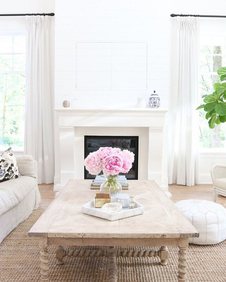 bright white living room designed by Stephanie Jean | home of Monika Hibbs | floral pillow from Arianna Belle