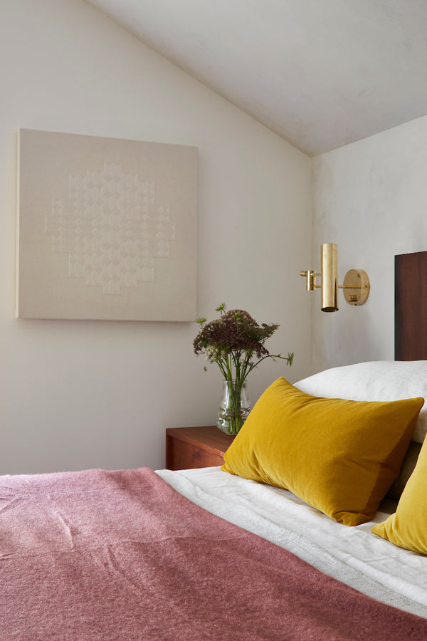 Before and After - Bedroom designed by Megan Bachmann with ochre golden yellow velvet pillows from Arianna Belle