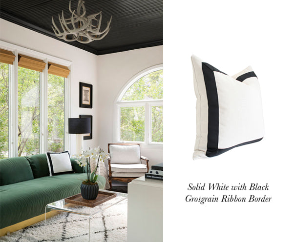 modern black white and green living room designed by Nicole Botsman featuring Solid White with Black Grosgrain Ribbon Border designer pillow from Arianna Belle