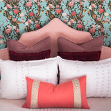 Coral with Greek Key Border Custom Designer Pillow on bed | Arianna Belle