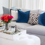 Betwixt Indigo Blue, Solid White with Black Grosgrain Ribbon Border, Marine Blue Velvet, La Fiorentina Brown Pillow Combo on sofa | Arianna Belle
