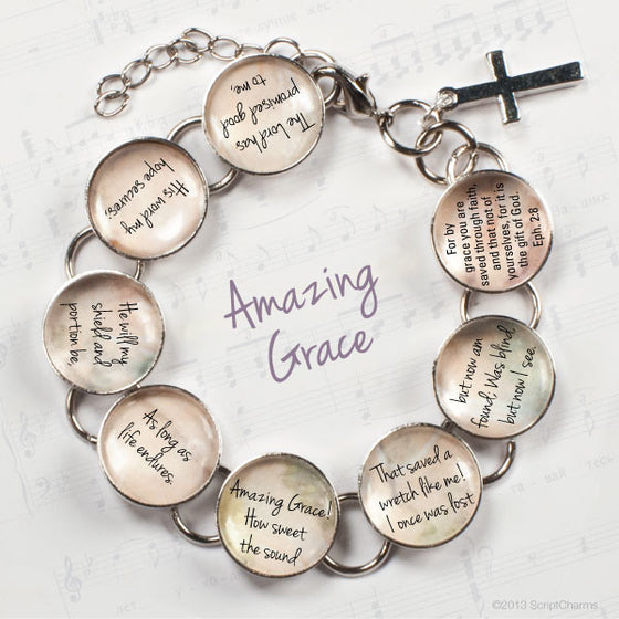 "You'll cherish this beautiful metal and glass charm bracelet featuring words from the classic hymn, ""Amazing Grace"", along with the accompanying Bible verse – Ephesians 2:8 – on eight glass charms, with a dangling cross charm:"