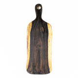 A live edge paddle-shaped rosewood root serving board viewed from above