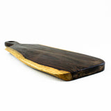 A live edge paddle-shaped rosewood root serving board