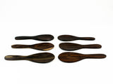 Several small paddle shaped rosewood spoons