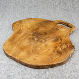 Natural edge teak serving board viewed from the front