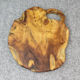 Natural edge teak serving board viewed from above