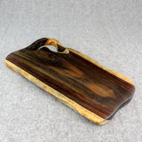 Natural edge rosewood serving board with handle