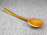 Long teak spoon