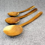 Three long teak spoons