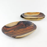Three small rosewood root plates