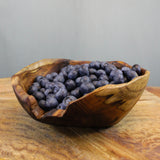 Teak root burly rice bowl full of blueberries