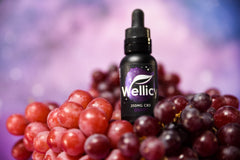 250MG Wellicy Grape CBD Oil Sitting on Grapes