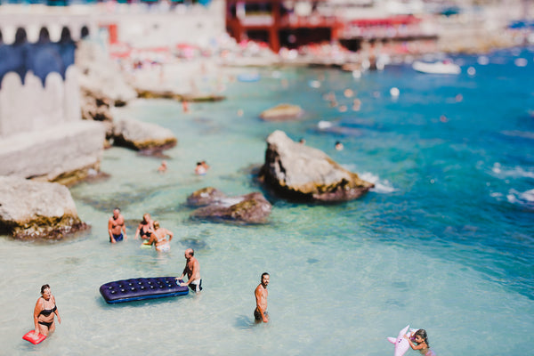Swimmers enjoy the turquoise waters in capri italy