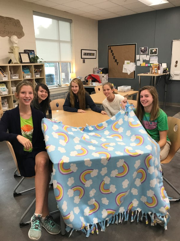 Isabella and her NJHS friends making fleece blankets