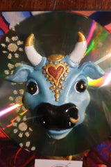 light blue Karma Cow CD fridge magnet