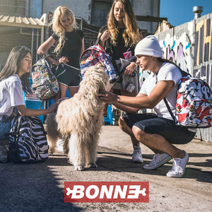 Boys and Girls carrying laptop backpacks and classic backpacks playing with a dog