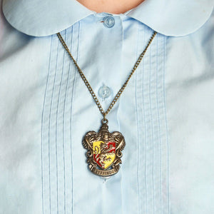 Harry Potter Jewellery Gryffindor House Crest Pendant Necklace with Medallion and Chain on model - Bronze-Gold