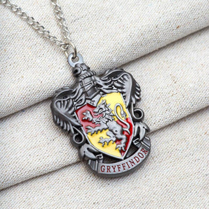 Harry Potter Jewellery Gryffindor House Crest Pendant Necklace with Medallion and Chain on textured background - Hematite
