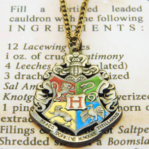 Harry Potter Jewellery Hogwarts Crest Pendant Necklace with Medallion and Chain on wizard's book