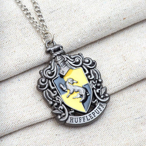 Harry Potter Jewellery Hufflepuff House Crest Pendant Necklace with Medallion and Chain on textured background - Hematite