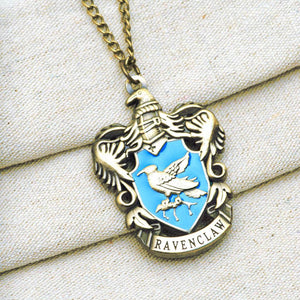 Harry Potter Jewellery Ravenclaw House Crest Pendant Necklace with Medallion and Chain on textured background - Bronze-Gold