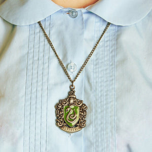 Harry Potter Jewellery Slytherin House Crest Pendant Necklace with Medallion and Chain on model - Bronze-Gold