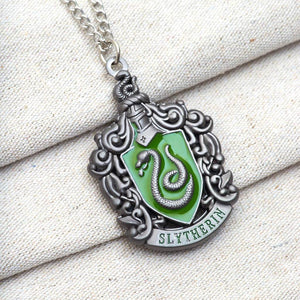 Harry Potter Jewellery Slytherin House Crest Pendant Necklace with Medallion and Chain on textured background - Hematite