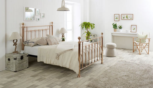 Classic metal bed frame in luxurious rose gold finish