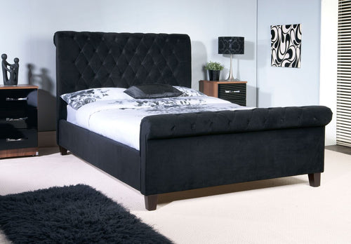 Black velvet chesterfield sleigh bed