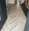 Volcanic Oak Herringbone Laminate
