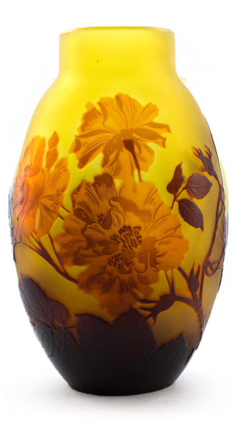 Authentic galle vase with saturated and deep red flowers on yellow mightylinksfo