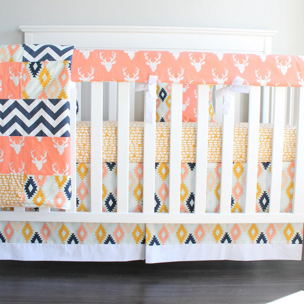 In Stock. Buck Coral Deer Crib bedding. Woodland Aztec deer coral, navy and mint girl crib baby bedding.