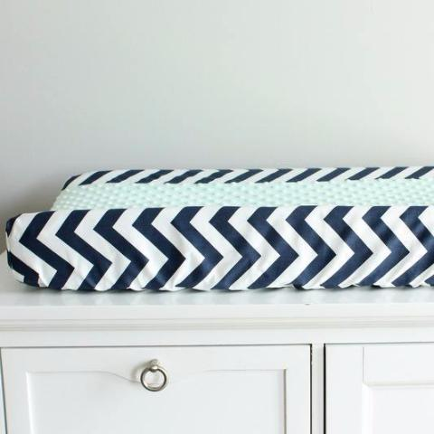 In Stock. Nursery Contour cover navy chevron with mint minky